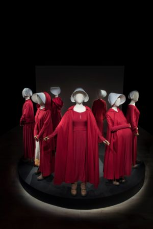 "See costumes from the hit show ""The Handmaid's Tale"" at SCAD FASH Museum of Fashion + Film."