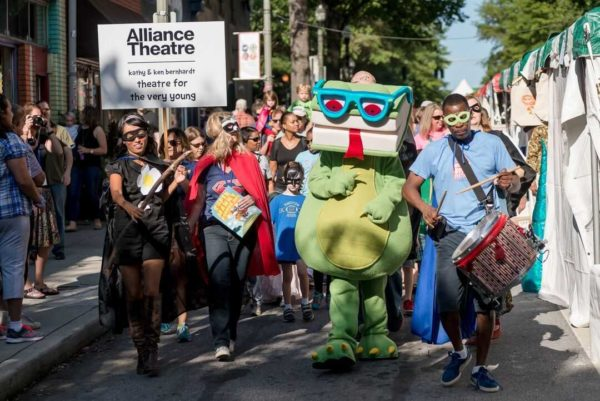 Bookzilla, the DBF mascot, leads the Children's Parade, which opens Saturday's and Sunday's festivities.