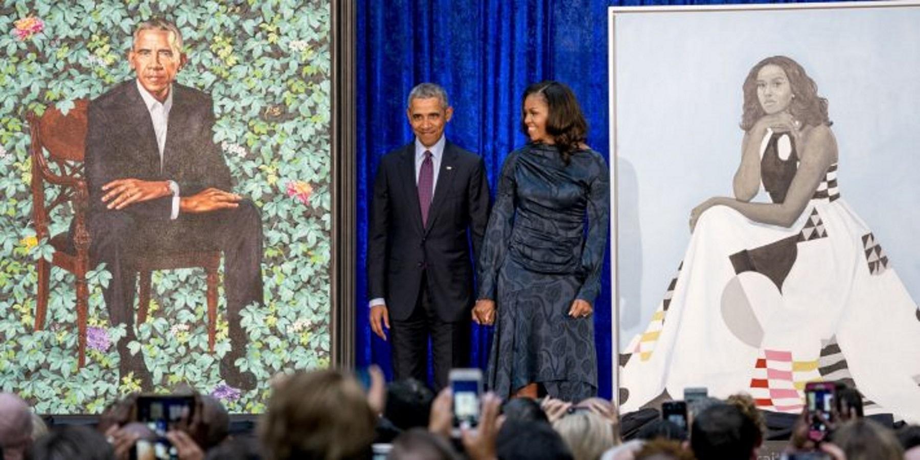Obamas next to their portraits