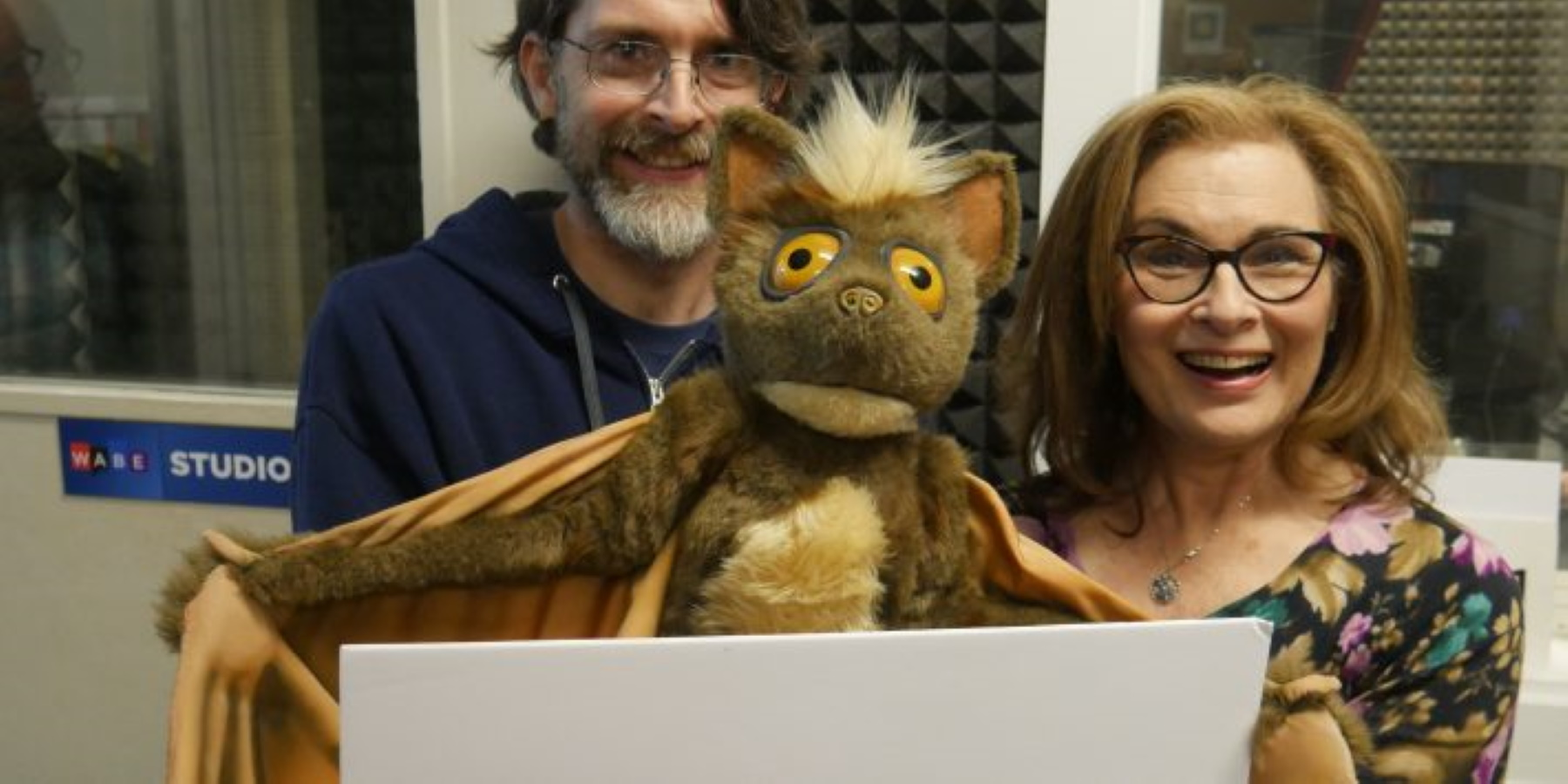 Jason Hines with a puppet, talks with Lois Reitzes